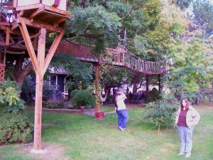 Visitors buzz around Maurice Xxxxx backyard treehouse complex in suburban Rochester, N.Y. Maury, as he tells visitors to call him, took years to raise and expand the Mystrees network and took direct aim at creating joy for kids of any age.